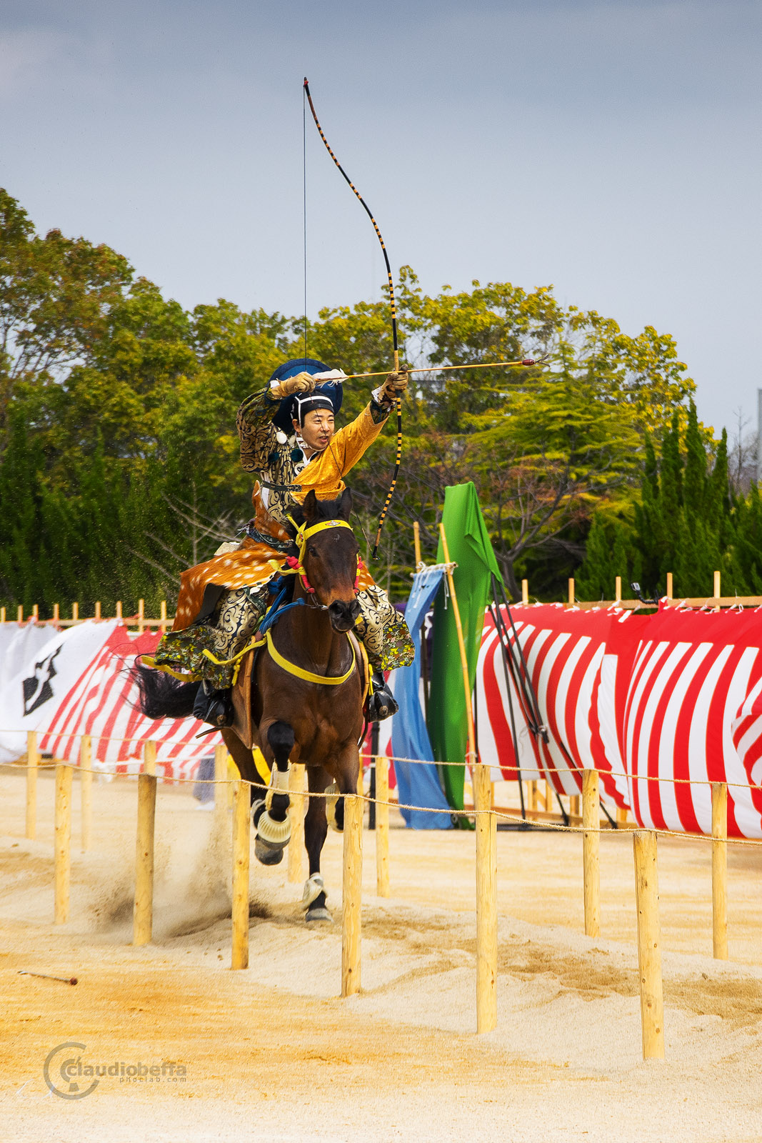 Japan, Yabusame, Traditional mounted archery, archer tightens his bow