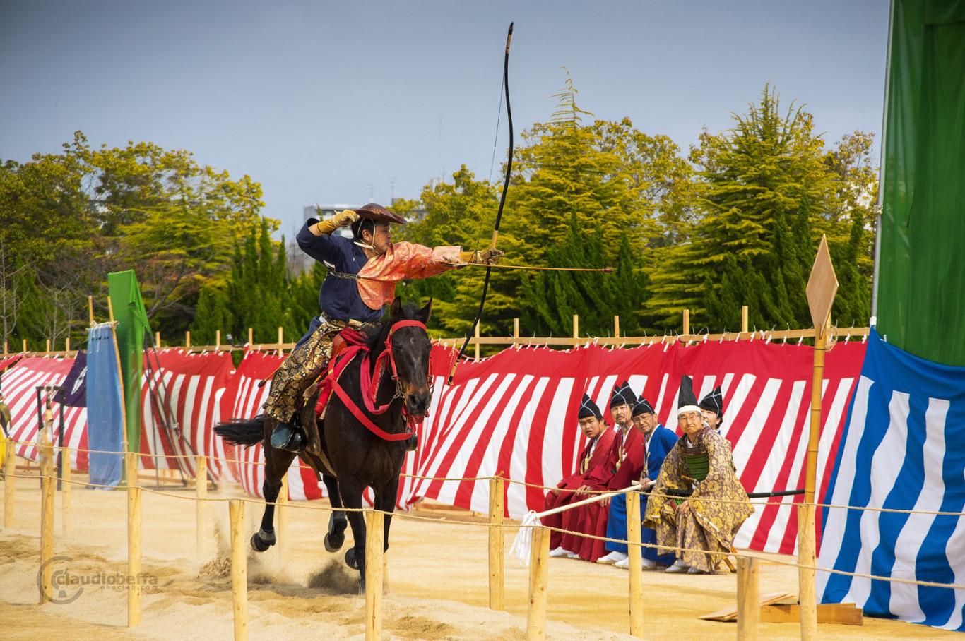Japan, Yabusame, Traditional mounted archery, archer shoots arrow