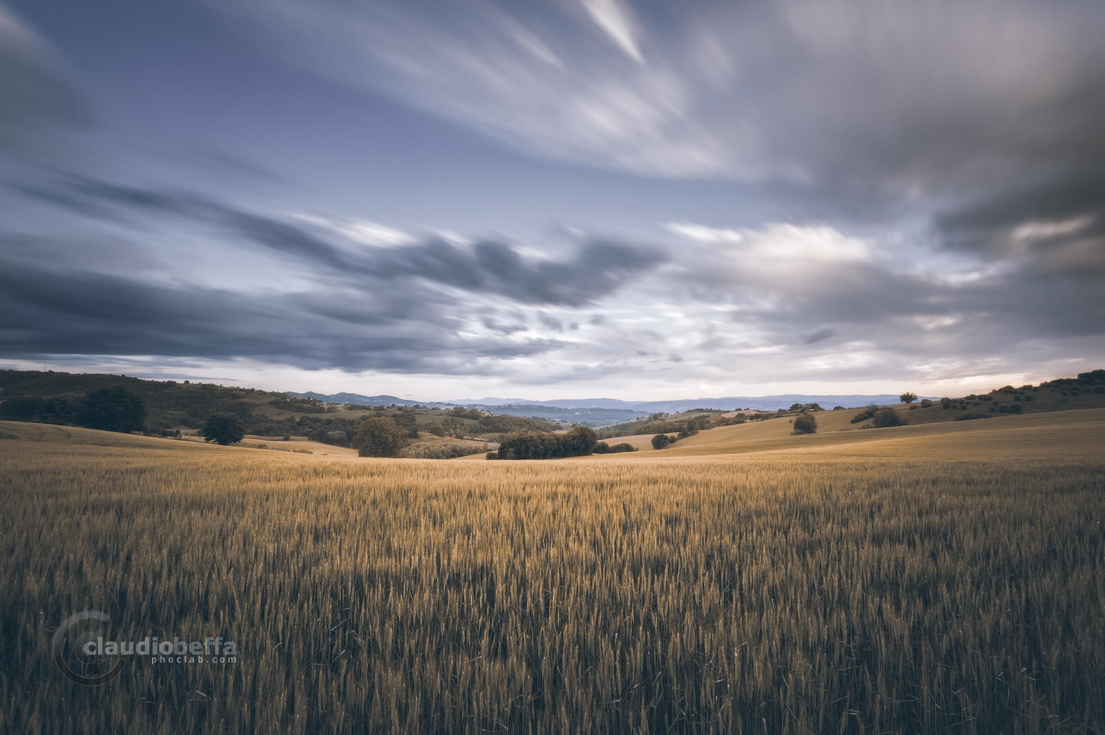 Rolling hills, hills, wheat, wind, clouds, sky, landscape, umbria, italy, long exposure