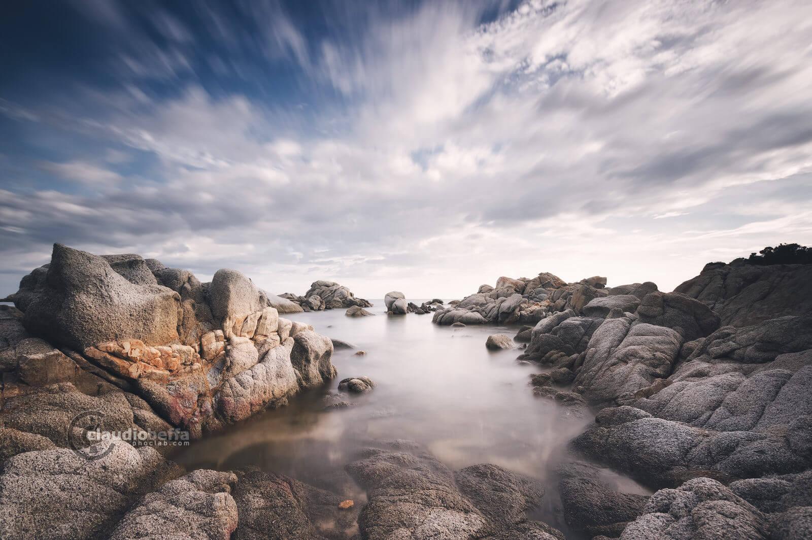 blunted teeth, rocks, cove, sea, water, sky, clouds, long exposure, sardinia, italy
